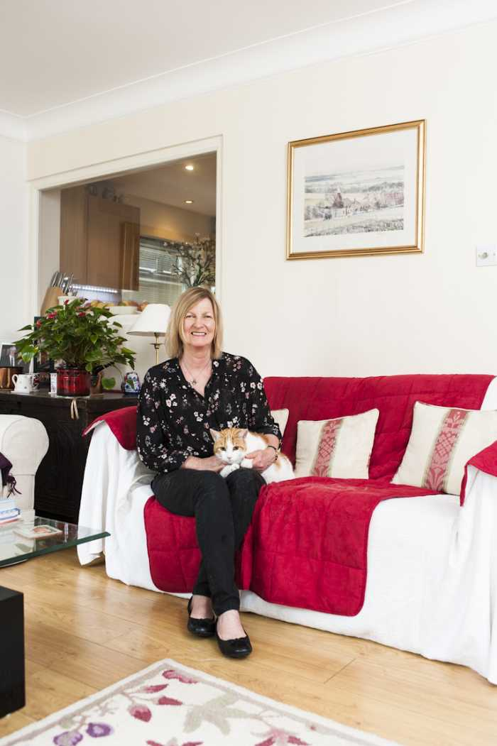 homesitter Ann King at home with pet cat